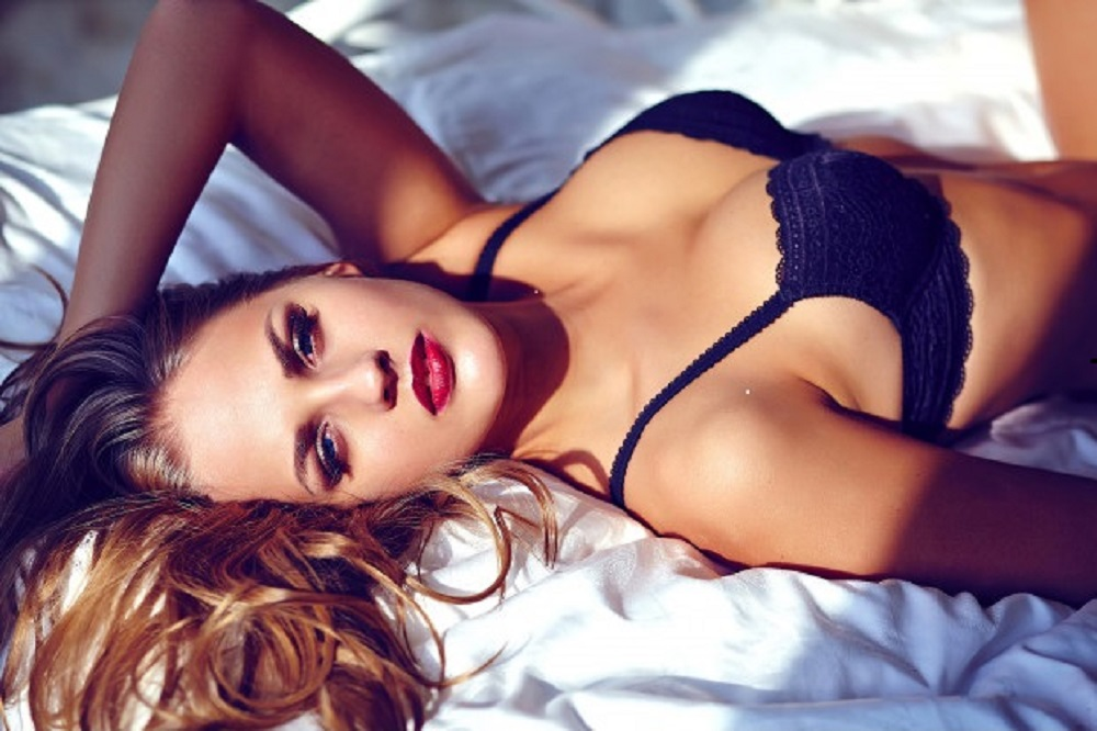 fashion-portrait-beautiful-young-woman-wearing-black-lingerie-white-bed_158538-10179